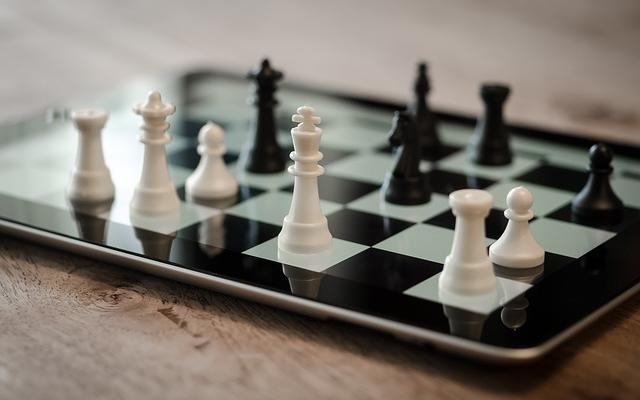 Image of chess pieces on an ipad